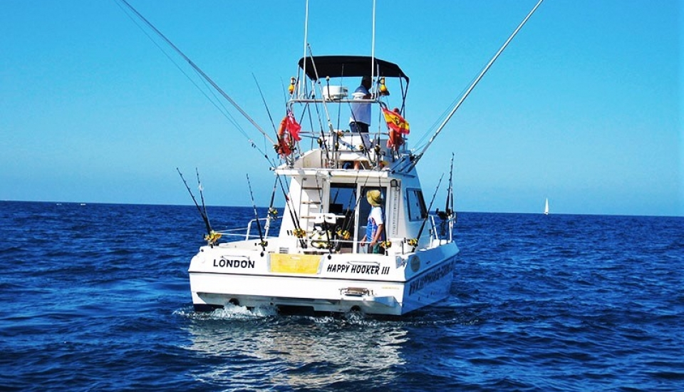 Fishing trip tenerife with happy hooker for Fishing boat trips